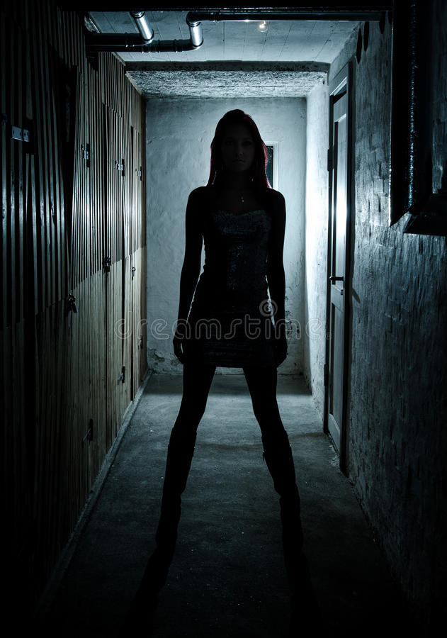 Beautiful Girl In Dark Basement Royalty Free Stock