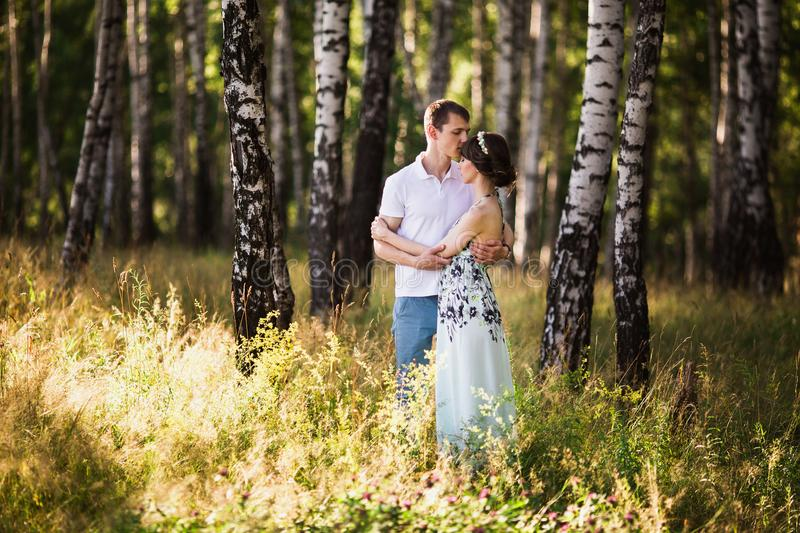 Loving couple in the forest stock photo