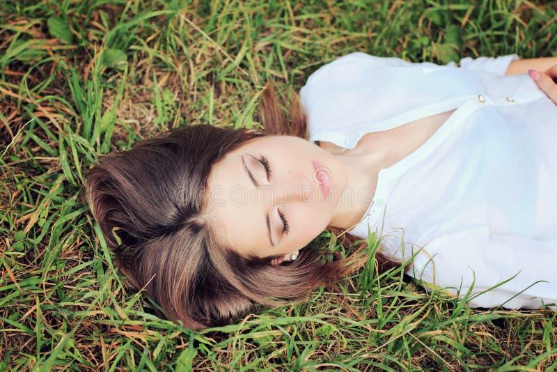 Beautiful girl with dark hair eyes closed. Portrait of beautiful girl with dark hair with eyes closed stock photo