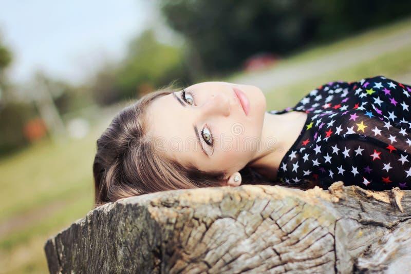 Beautiful girl dark hair with large eyes smart stock photos