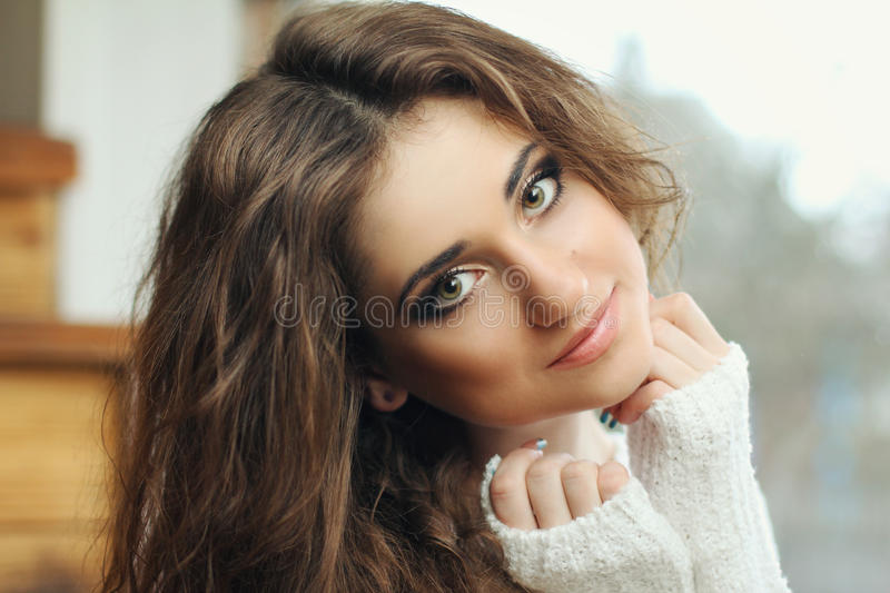 Beautiful girl dark hair with large eyes smart stock images
