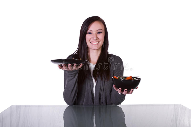 Download Beautiful Girl Deciding What To Eat Stock Image - Image of happy, holding: 12551227