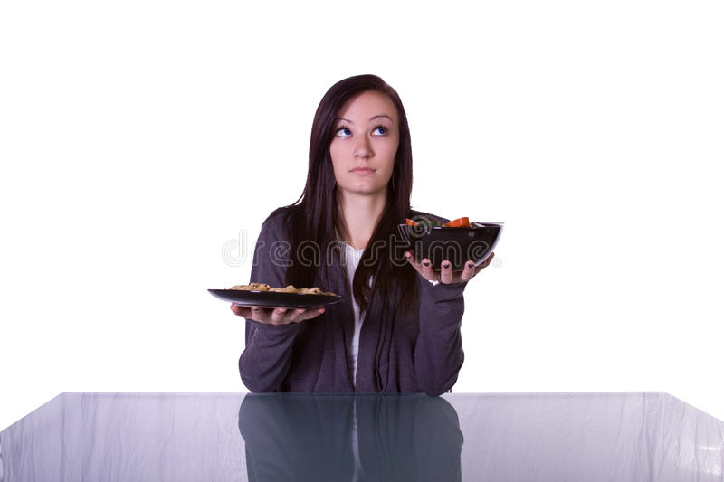 Download Beautiful Girl Deciding What To Eat Stock Image - Image: 13268411