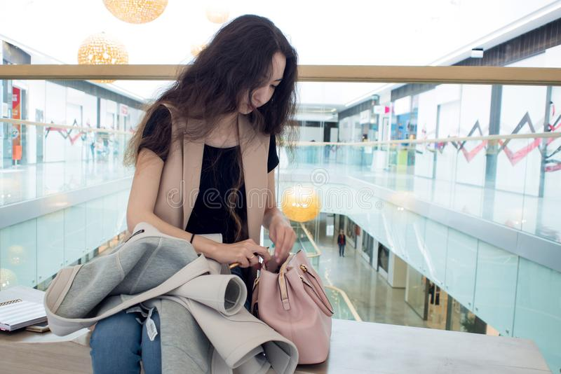 Beautiful girl with a diary in hand, the portrait in the lobby of shopping Mall or business center. Beautiful girl with a diary in hand, the portrait in the stock photo