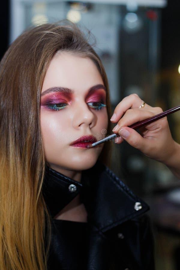 Beautiful girl doing make up, make up artist work stock photography
