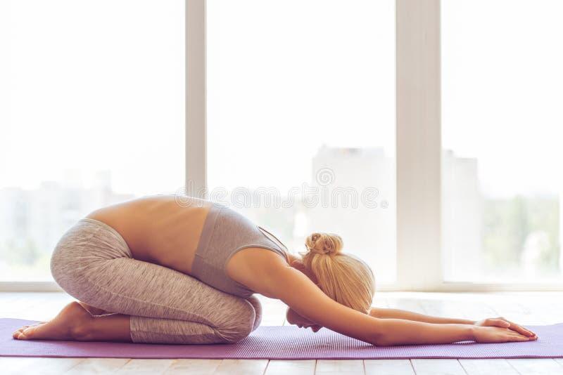 Beautiful girl doing yoga stock image