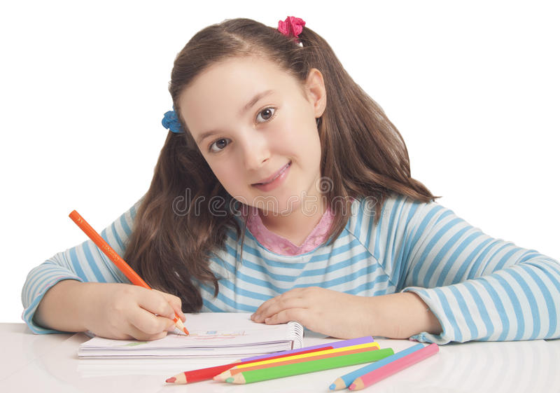 Beautiful girl is drawing with color pencils