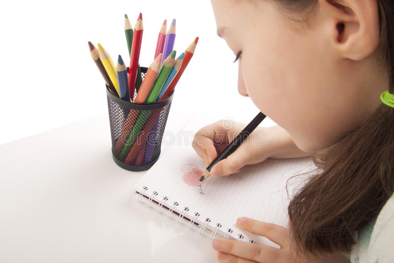 Download Beautiful Girl Is Drawing With Color Pencils Stock Photo - Image of school, isolated: 29652926