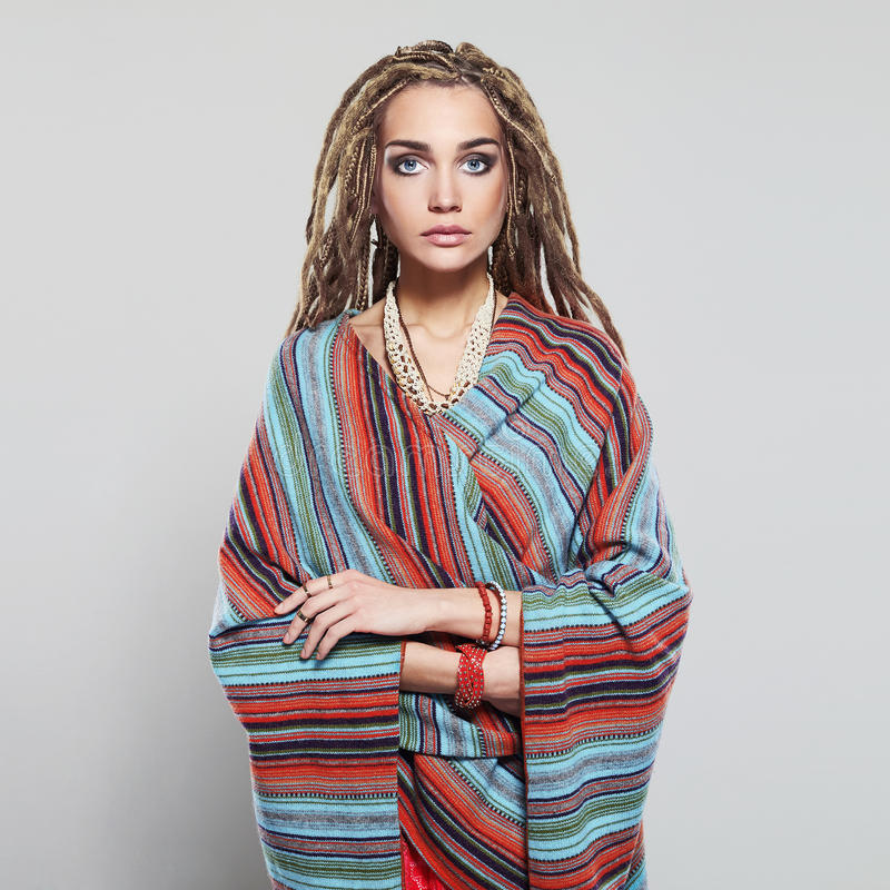 Beautiful girl with dreadlocks. pretty young woman with braids African hairstyle hippie. Cosmetic make-up royalty free stock photo