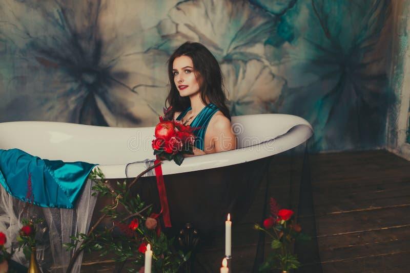 Beautiful girl in a dress in the bath stock image