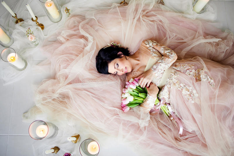 Beautiful girl in a dress with a bouquet royalty free stock image