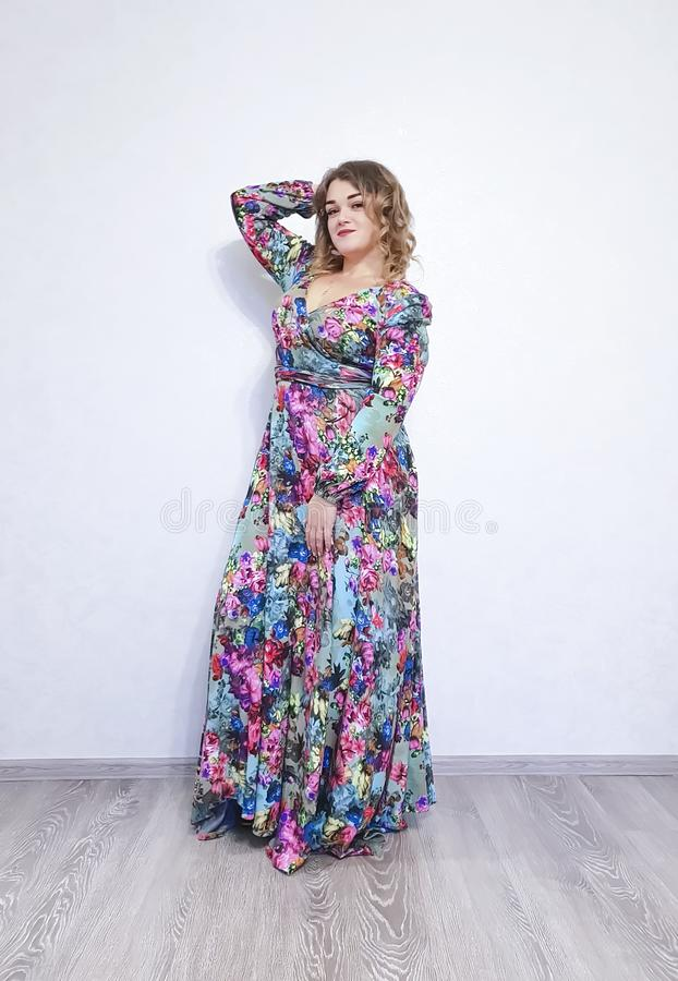 Beautiful girl in dress, curly hair posing attractive figure stock photos