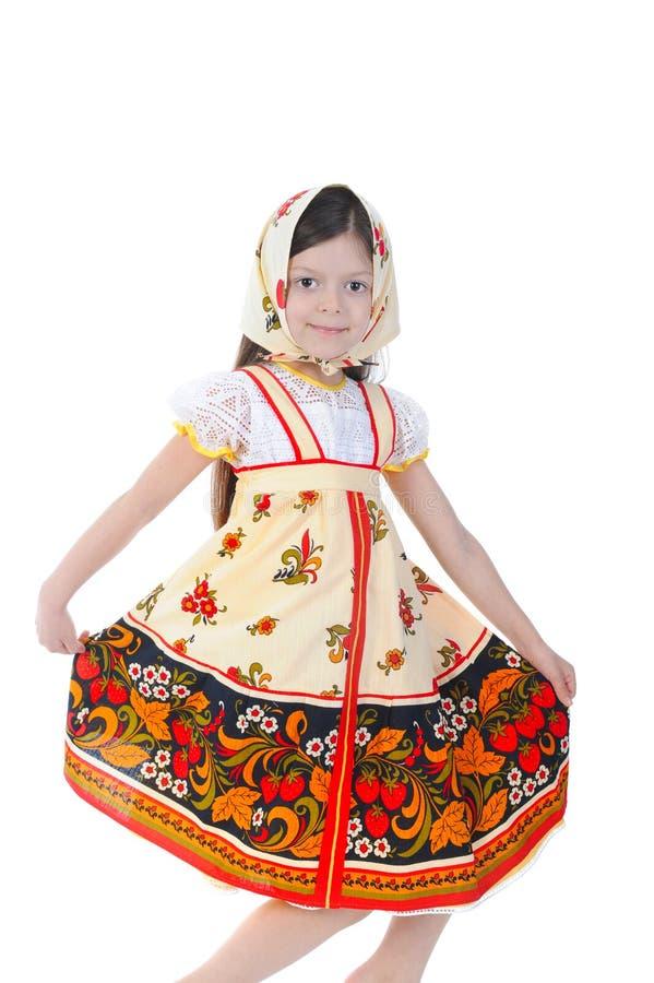 Beautiful girl in a dress dances. stock image
