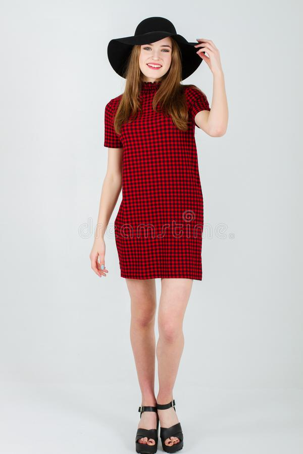 Beautiful girl in dress and hat stock photography