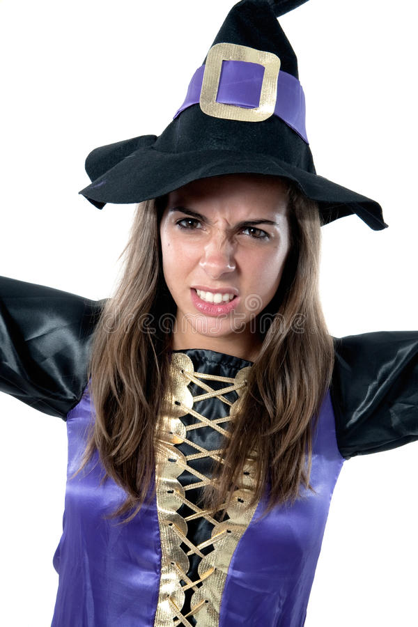 Beautiful girl dressed in evil witch. Isolated on white background stock photo