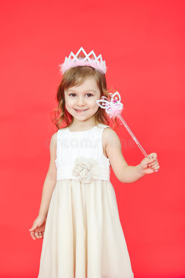 Beautiful girl dressed in fairy isolated on white background. Vertical portrait of beautiful girl dressed in fairy isolated on red background. Cute little kid stock photos