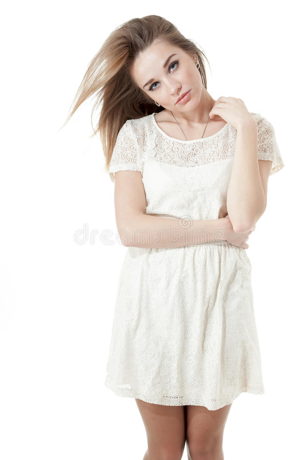 Beautiful girl dressed in a short white dress, royalty free stock photo