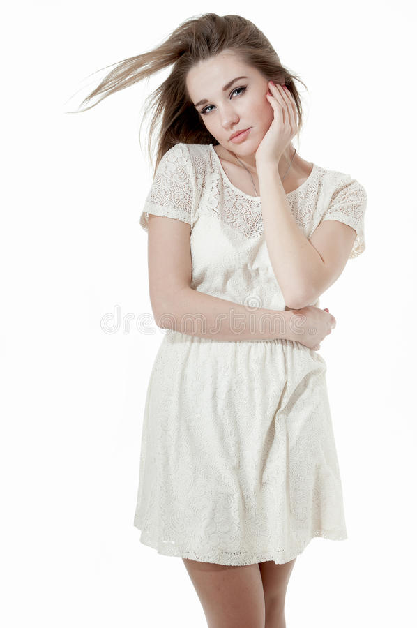 Beautiful girl dressed in a short white dress stock photo