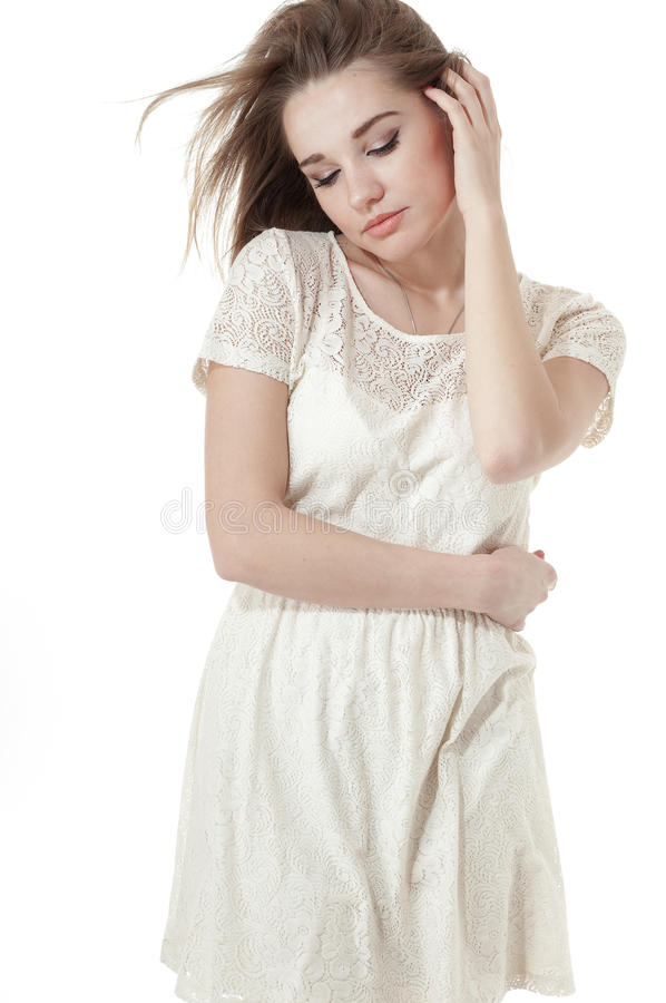 Beautiful girl dressed in a short white dress royalty free stock photos