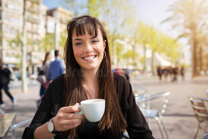 Beautiful girl drinking coffee royalty free stock image