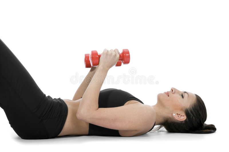 Beautiful girl with dumbbells royalty free stock photography