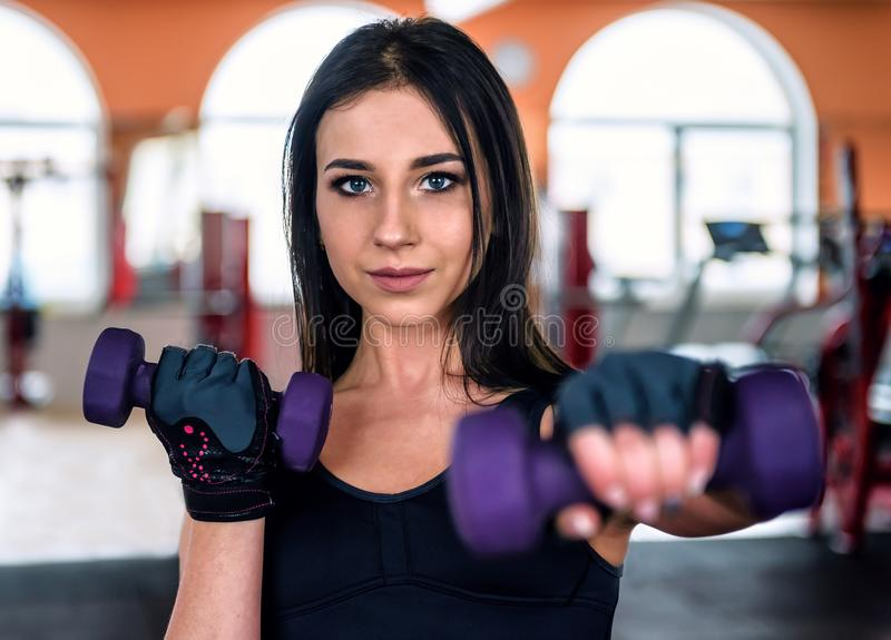 Beautiful girl with dumbbels stock image