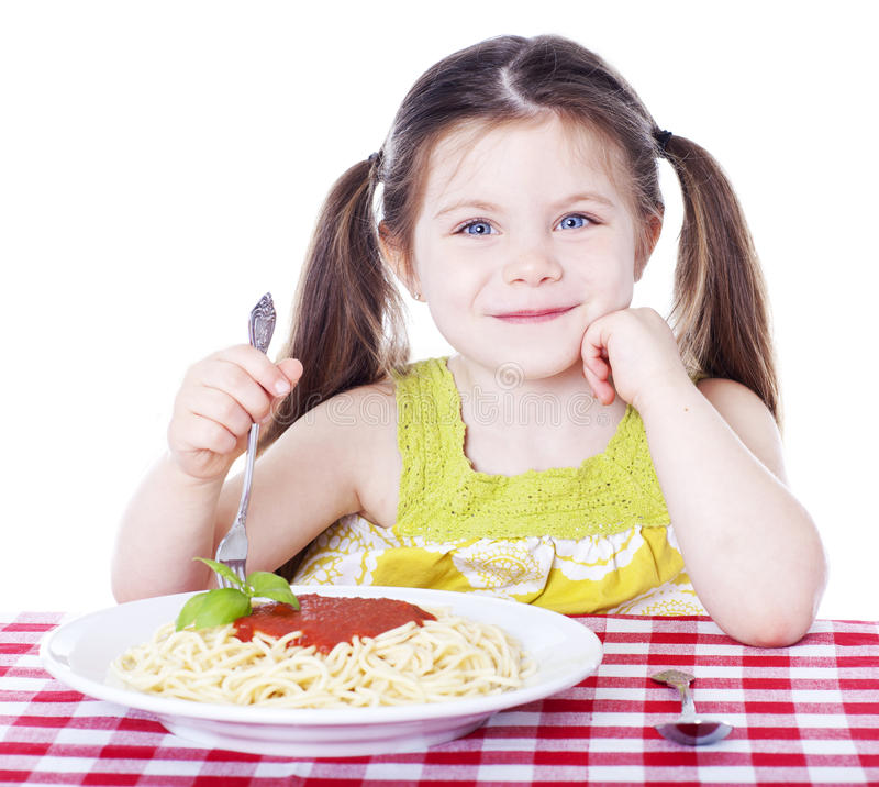 Beautiful girl eating a bowl of pasta with sauce royalty free stock photography