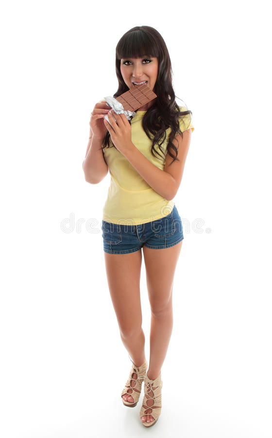 Beautiful girl eating chocolate stock image
