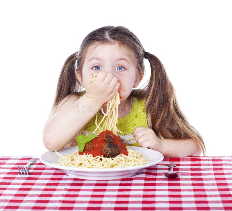 Beautiful girl eating pasta and meatballs royalty free stock photos