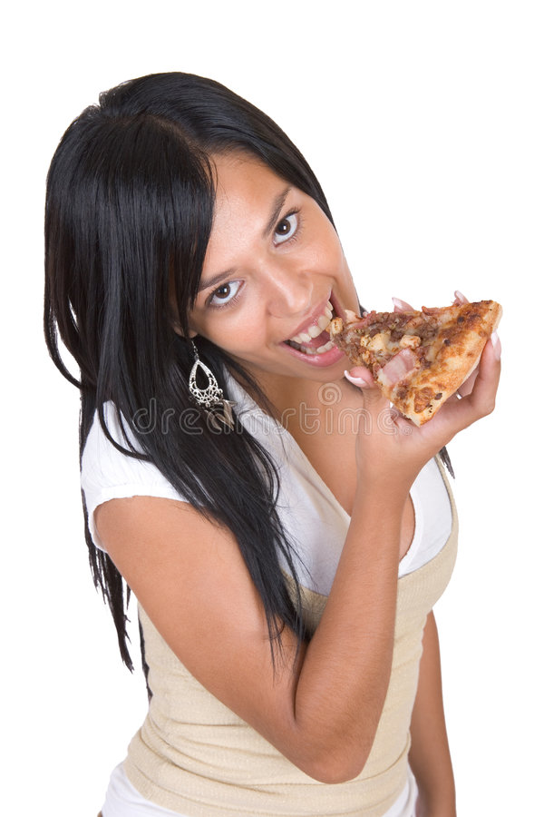 Beautiful girl eating pizza royalty free stock photo