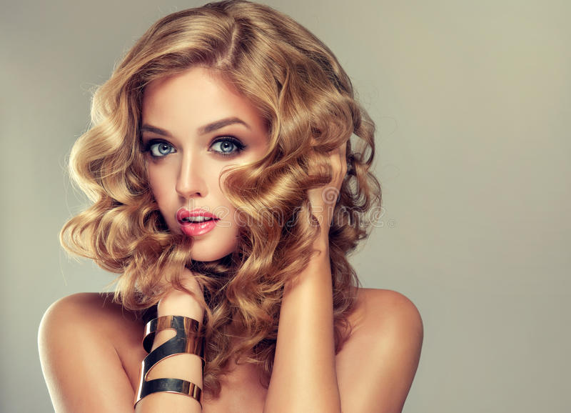 Beautiful girl with an elegant hairstyle. royalty free stock photo
