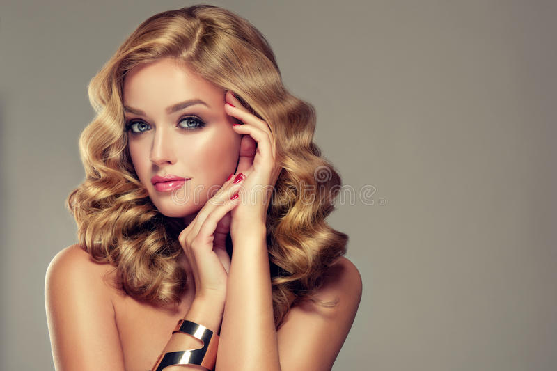Beautiful girl with an elegant hairstyle. royalty free stock photos