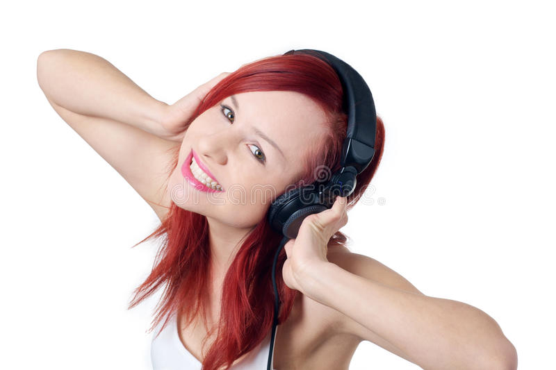 Beautiful girl enjoying music royalty free stock photography