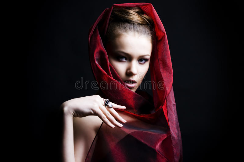 Download Beautiful Girl Enveloped  In Red Headscarf Stock Image - Image: 13540641