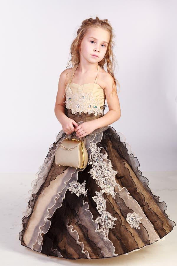 Beautiful girl in evening dress stock photos