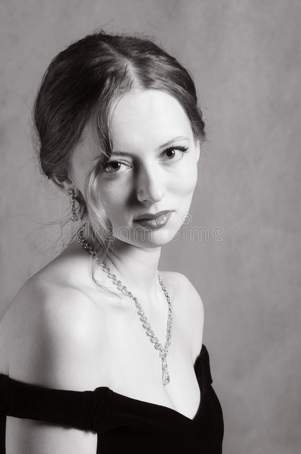 Beautiful girl in evening dress with neckline stock photos