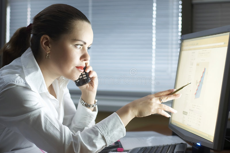 Download Beautiful Girl In The Evening Sits At Office Stock Photo - Image: 7972714