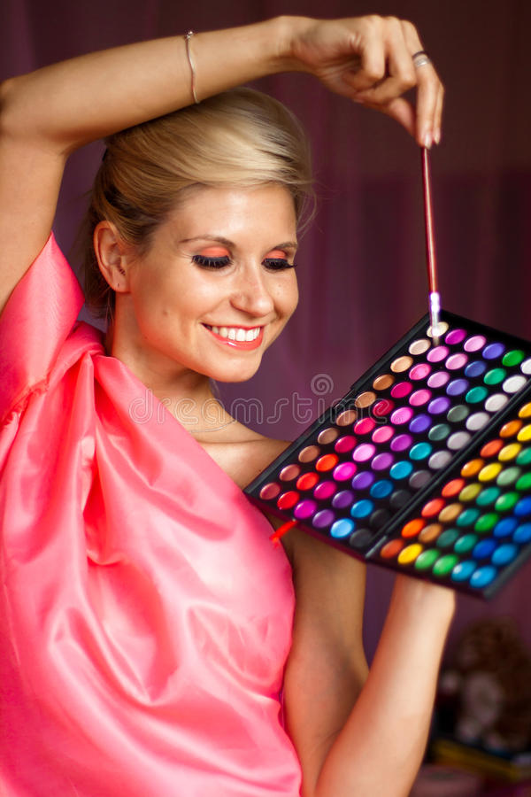 Beautiful girl with eye shadow for make-up stock image