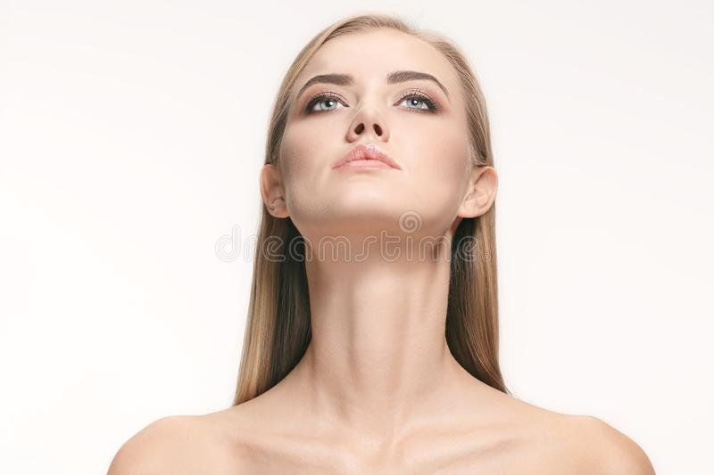 Beautiful Girl face. Perfect skin. The beautiful female face. The perfect and clean skin of face on white royalty free stock image