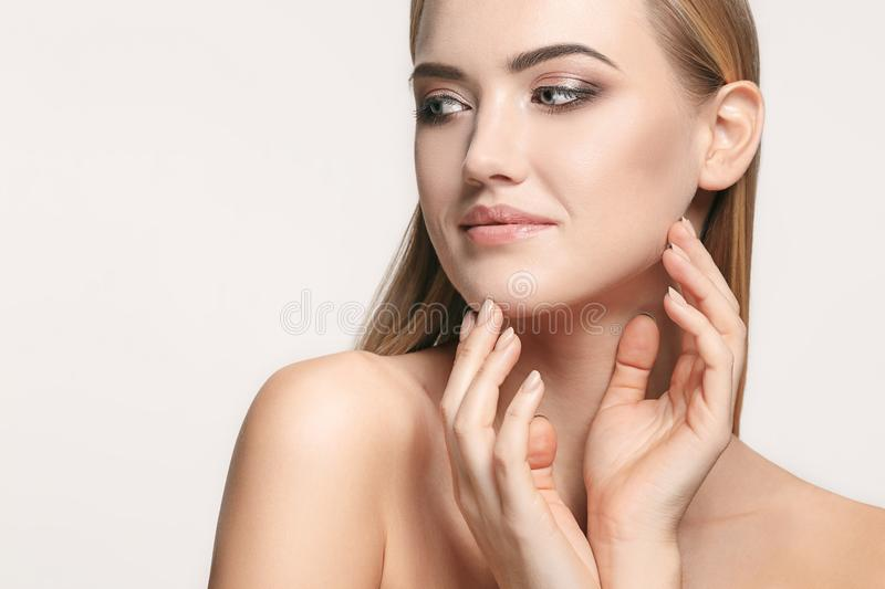 Beautiful Girl face. Perfect skin. The beautiful female face. The perfect and clean skin of face on white stock photos