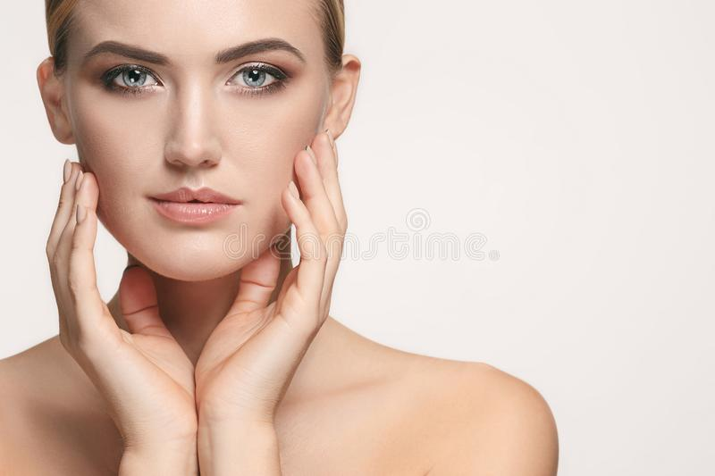 Beautiful Girl face. Perfect skin. The beautiful female face. The perfect and clean skin of face on white royalty free stock photo