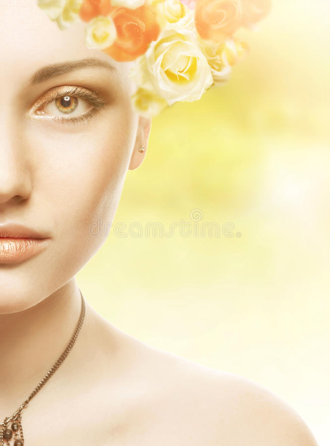 Beautiful Girl Face.Whits Perfect skin with flowers. Beautiful Spring Girl with flowers royalty free stock images