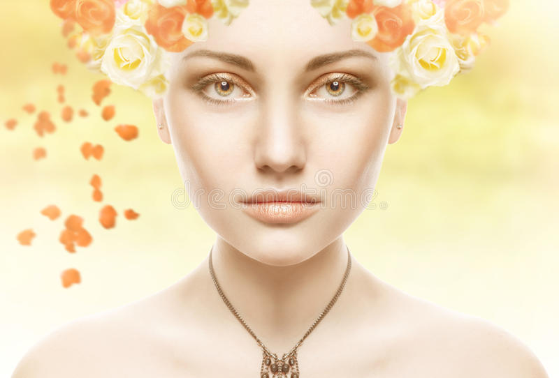 Beautiful Girl Face.Whits Perfect skin with flowers. Beautiful Spring Girl with flowers stock photo