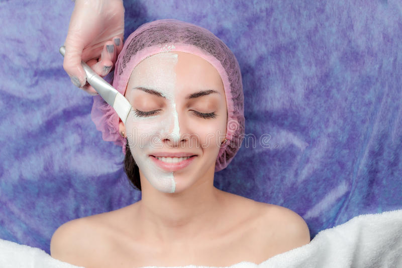 Beautiful Girl with facial mask at beauty salon royalty free stock photo