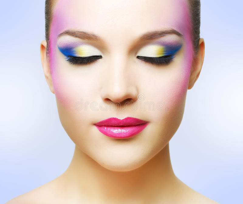 Beautiful girl with fashion bright makeup stock photography