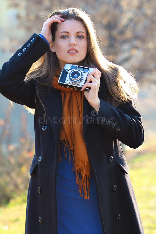 Download Beautiful Girl In Fashion Pose With Old Camera In Hand Stock Image - Image: 28907371