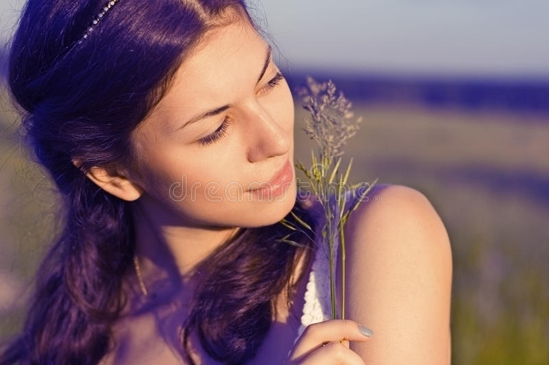 beautiful girl in field stock photo
