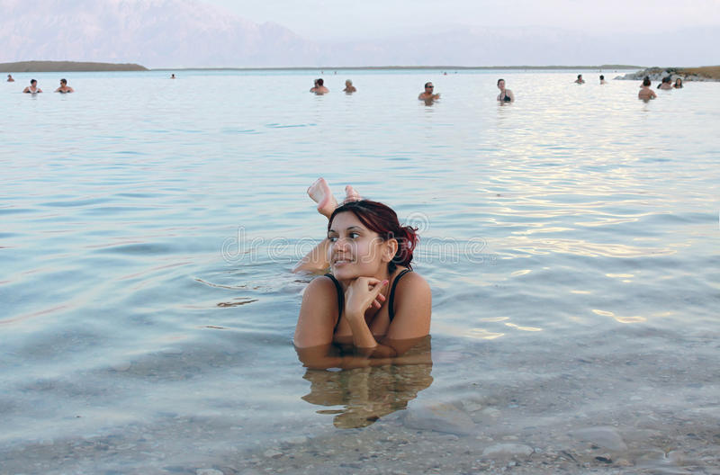 Beautiful girl floated in the Dead Sea stock image