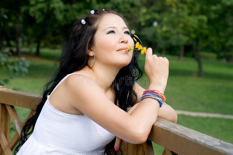 Beautiful girl with a flower royalty free stock photos