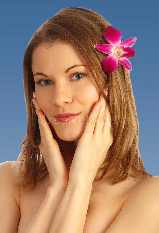 Download Beautiful Girl With A Flower In Her Hair Stock Photo - Image: 9537174